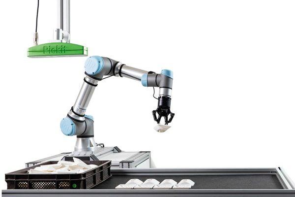 Mit Hilfe der 3D-Kamera von Pickit kann der Cobot von Universal Robots unsortierte Bauteile aus einer Kiste entnehmen. Wir sind Experten für Roboter Zubehör.